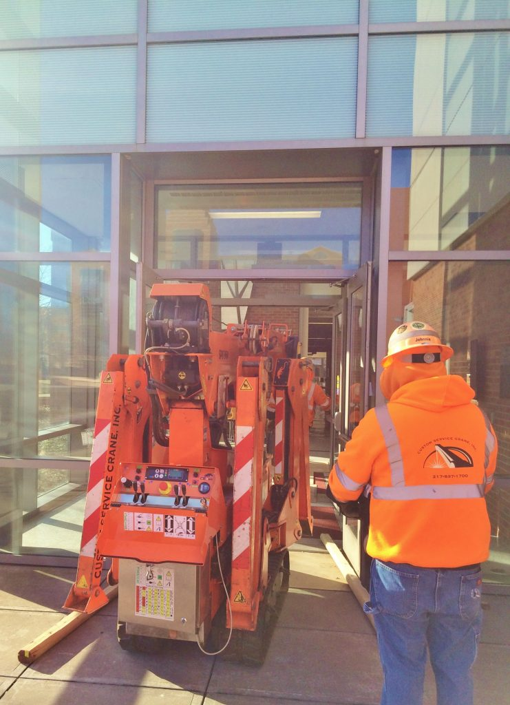 Jekko mini crane passing easily through standard door entry.