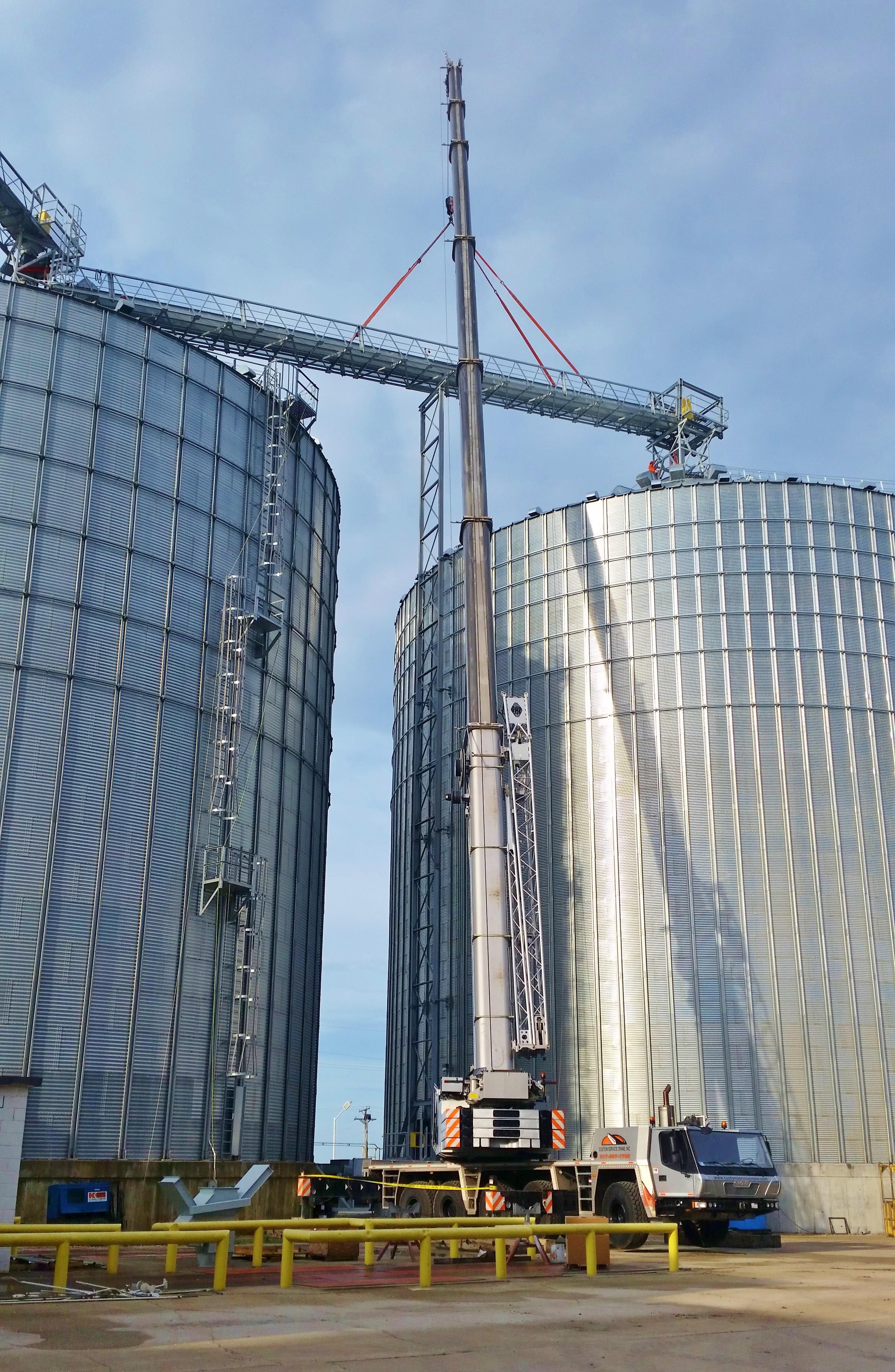 275 ton hydraulic crane hoisting a bridge truss at grain bins