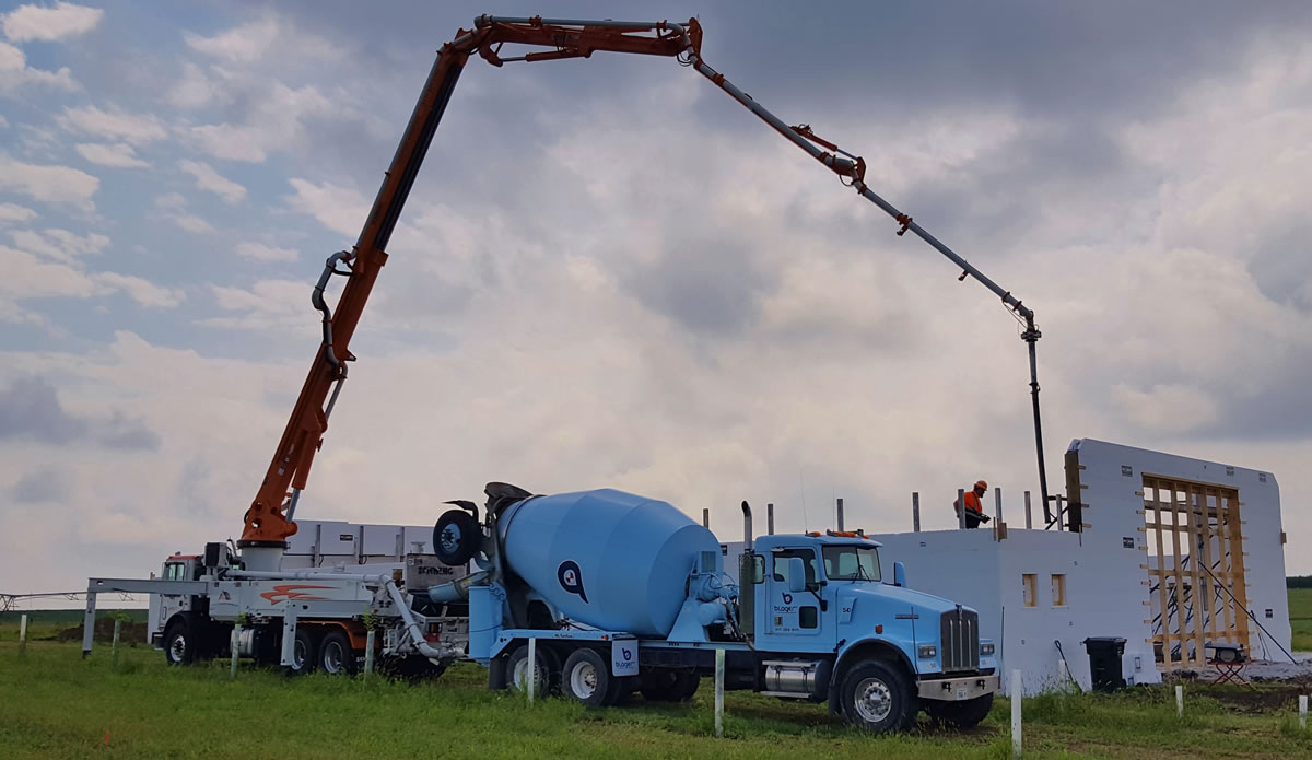 31 meter Z boom truck pumping into an insulated concrete forms (ICF) building. ICF construction provides improved insulation and noise reduction.