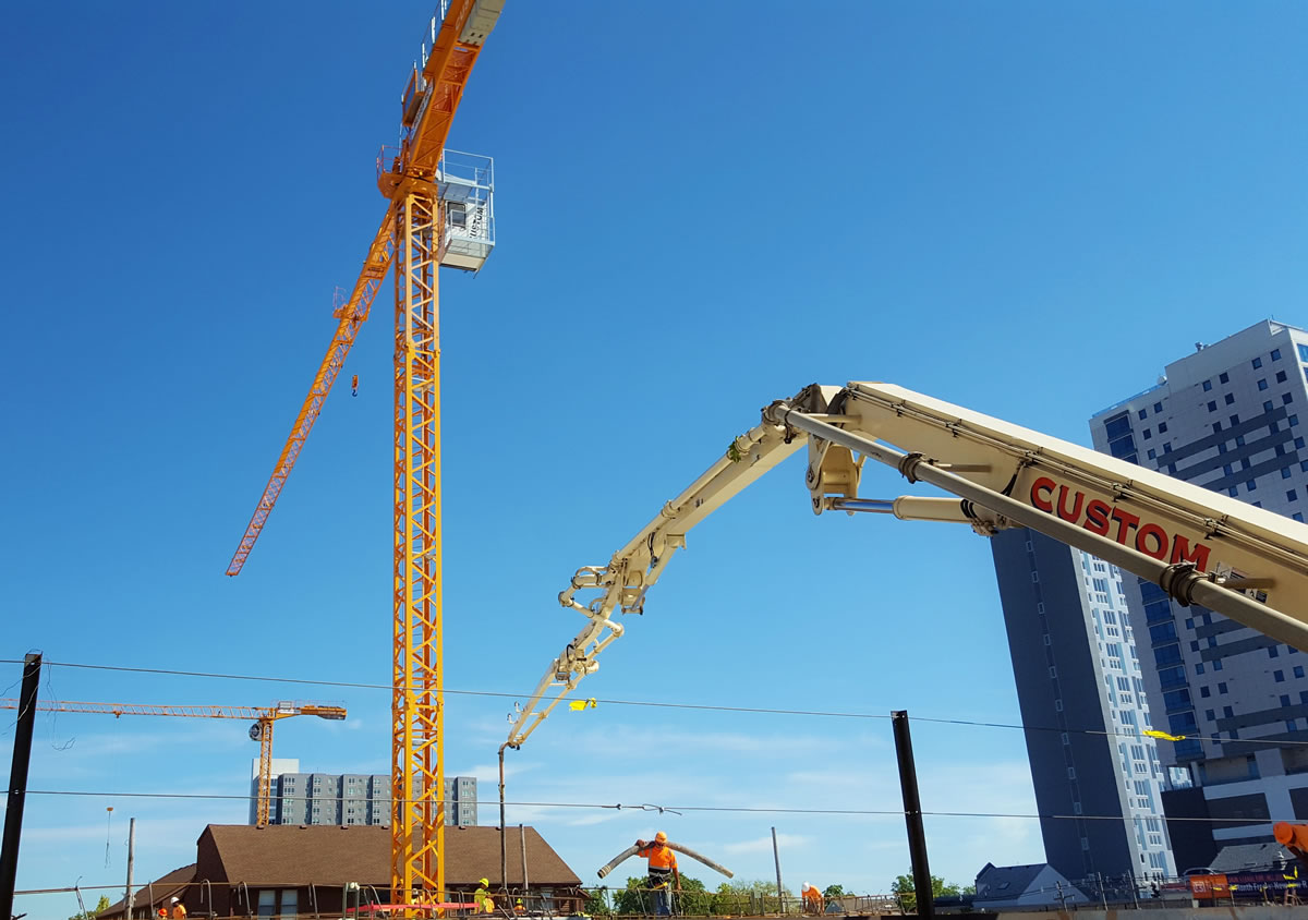 pump truck with two tower cranes on campus in Champaign