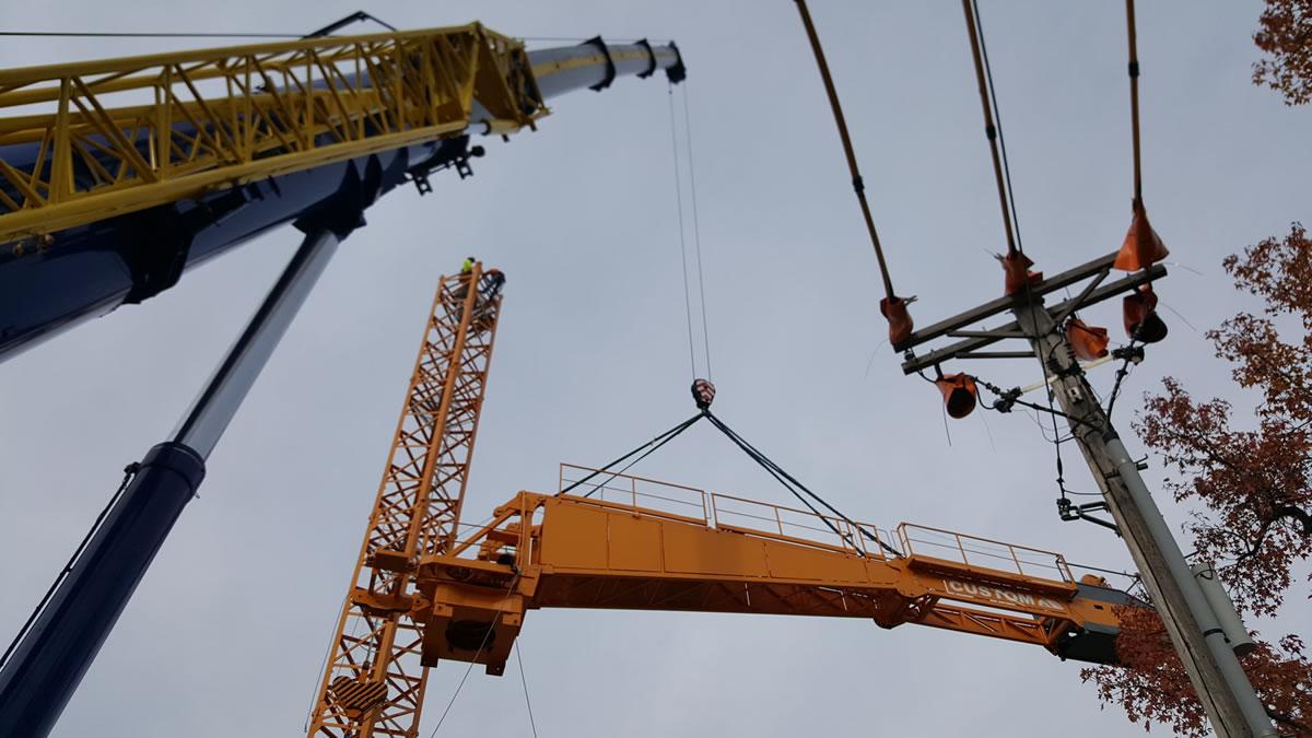 tower crane in Clayton, MO setting jib