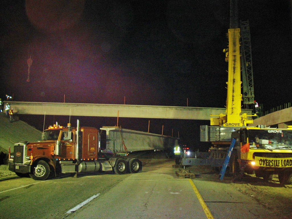175 ton hydraulic crane hoisting bridge beams on Interstate 57.