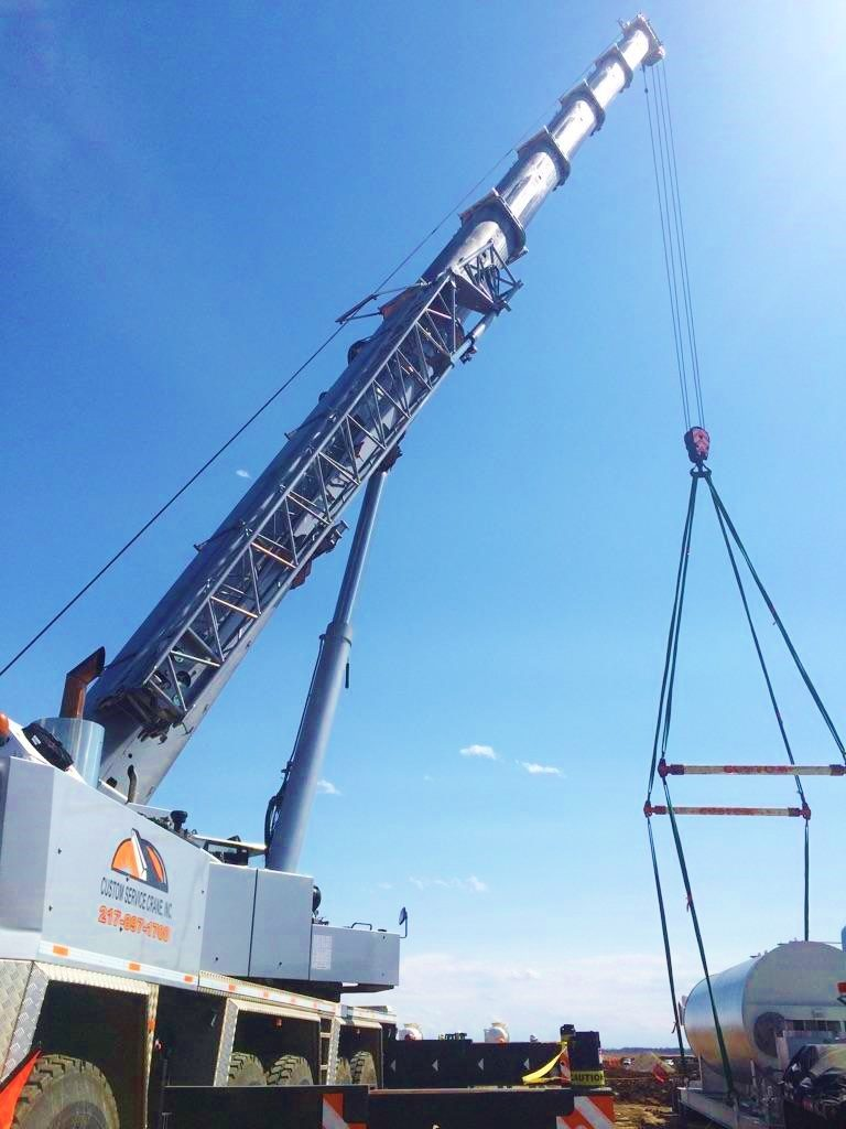 Our 275 ton using spreader beams and straps to secure a new water tank.