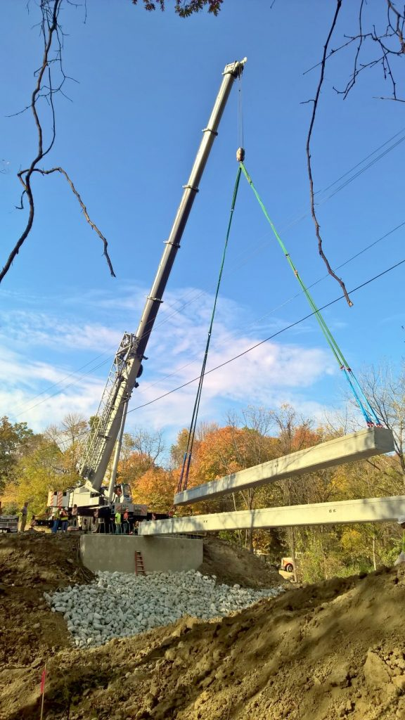 Bridge beams being set by a 275 ton crane in Oakwood, IL.