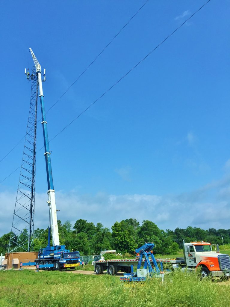 175 ton crane is hoisting new antennas for a cell tower.
