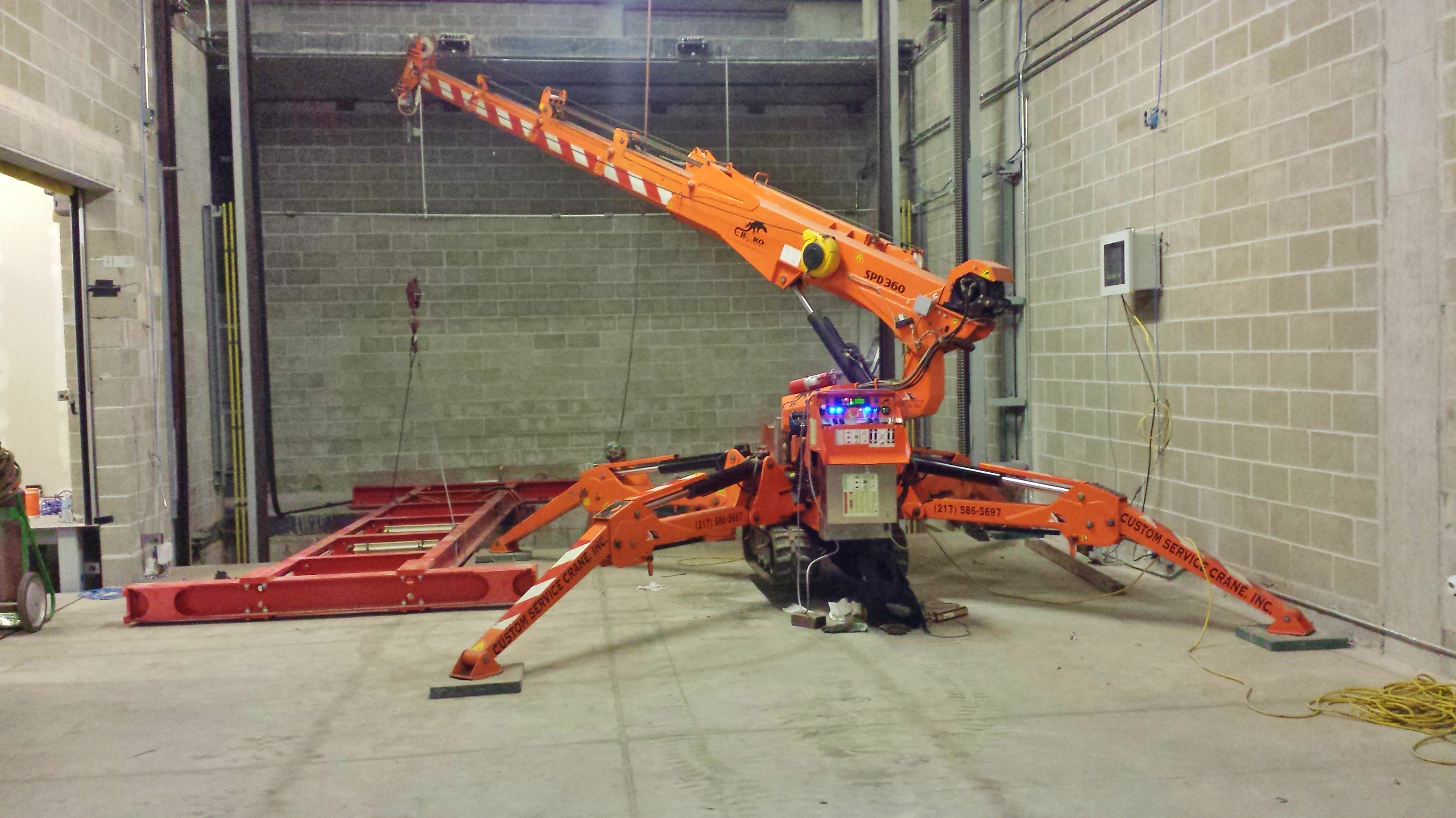 Jekko mini crane is installing an automated parking garage in Champaign, IL.